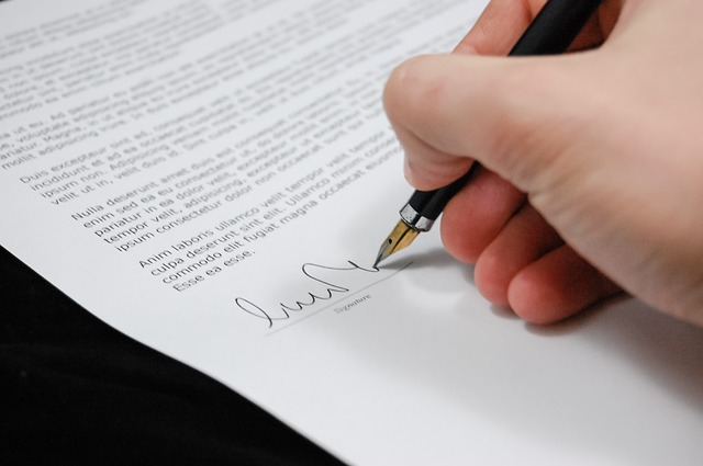 A document being signed by hand